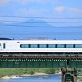Photos: 奥多摩の山々を背景に多摩川橋梁を渡るE351系特急電車