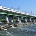 多摩川橋梁を渡るE351系中央線特急電車