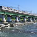 Photos: 多摩川橋梁を渡る209系電車