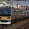 Photos: 休日運転のため西荻窪駅を通過する209系快速電車