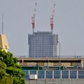 写真: 庄内川沿いから見えた、建設途中の御園座ビル - 1