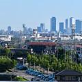 写真: イオン小牧店から見たザ・シーン城北と名駅ビル群