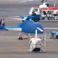 Photos: 県営名古屋空港:移動中のカバーがかったヘリコプター