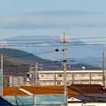Photos: 春日井市内から見えた薄っすら雪を頂く恵那山と笠雲 - 4