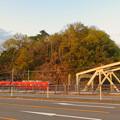 Photos: 犬山橋から見た鵜沼城跡の岩山と名鉄電車