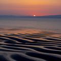 写真: 夕暮れの海岸