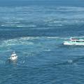 Photos: 渦潮と格闘する観光船