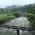Photos: 大雨で増水の水俣川
