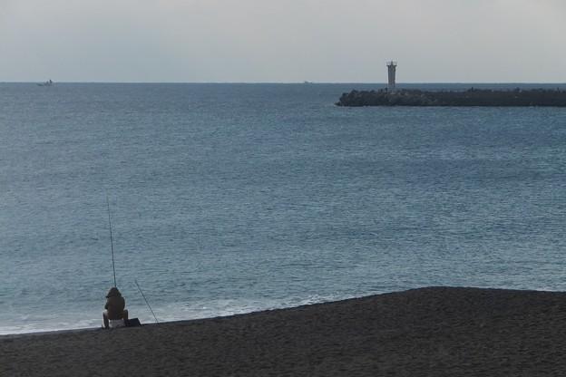 釣り人/灯台