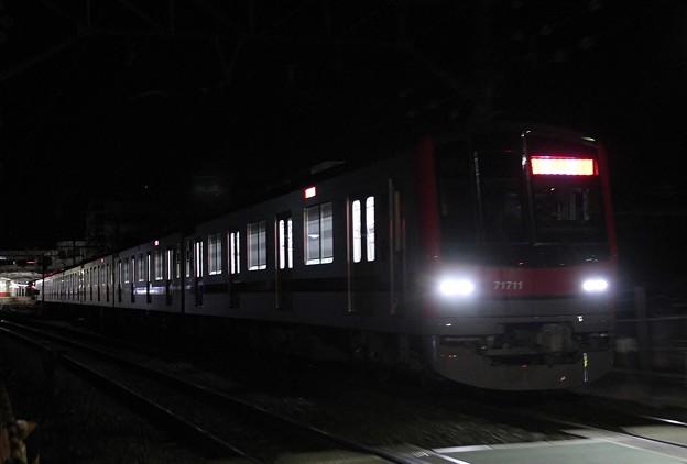 71711F