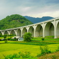 写真: 「ローマン橋と実る田」